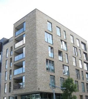 grey-tall-brick-apartment-building